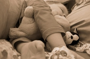 Co-sleeping child in bed